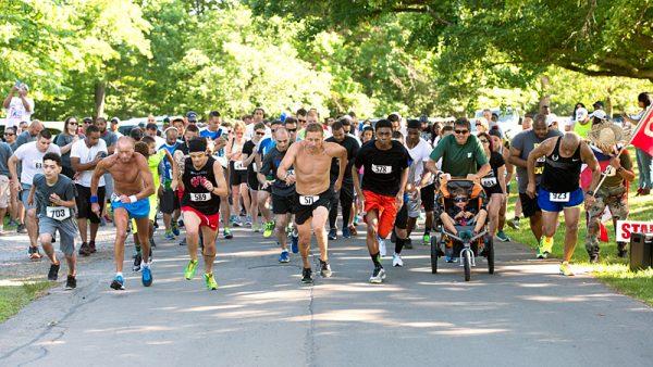 Racers begin the SSGT Javier Ortiz Memorial 5K Race and Fitness Walk June 25 at Rochester's Seneca Park.