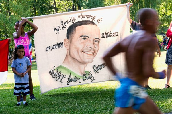 During the race, spectators hold a banner honoring Javier Ortiz.