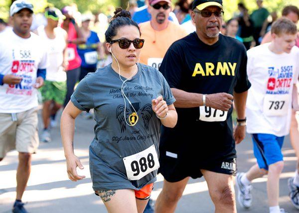 Veronica Ortiz, wife of Javier Ortiz, begins the race in memory of her late husband.