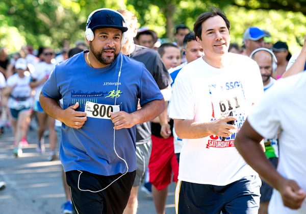 Julio Jordan (left) and Mark Assini leave the starting line at the beginning of the race.