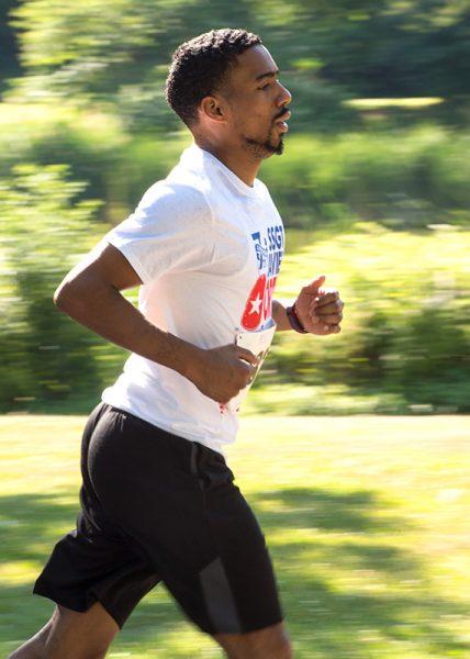 Robert Feliciano runs in Seneca Park during the race.