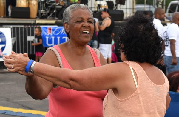 Marta Martinez, left, dances with Luz Figueroa during the 47th annual Puerto Rican Festival in Rochester, Friday, August 5.