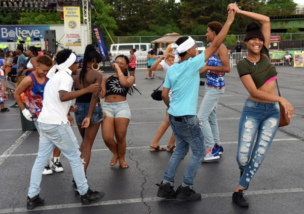 Kids dance during the 47th annual Puerto Rican Festival in Rochester, Friday, August 5.