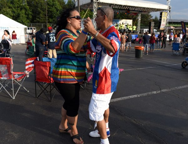Martha, left, and Tito Maldonado dance during the 47th annual Puerto Rican Festival in Rochester, Friday, August 5.