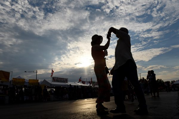 A couple dance during the 47th annual Puerto Rican Festival in Rochester, Friday, August 5.