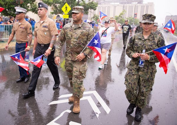 Latino veterans carry flags as they march in the annual Puerto Rican Parade Aug. 17.