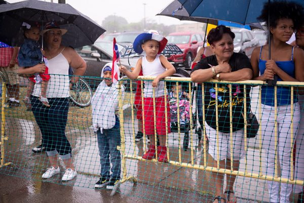 Paradegoers line the street in the rain to watch the annual Puerto Rican Parade Aug. 17.