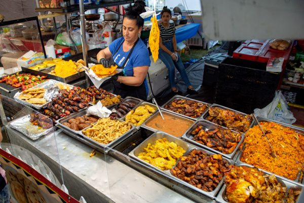 Puerto Rican food is prepared under the food tent Aug. 16.
