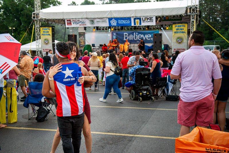Festivalgoers dance to the music of Banda Light Aug. 16.