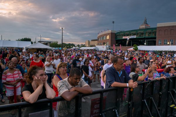 Festivalgoers watch live music in Frontier Field's VIP lot Aug. 16.