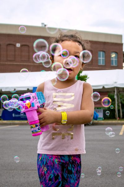 Four-year-old Bae'le Ngo blows bubbles during the festival Aug. 16.