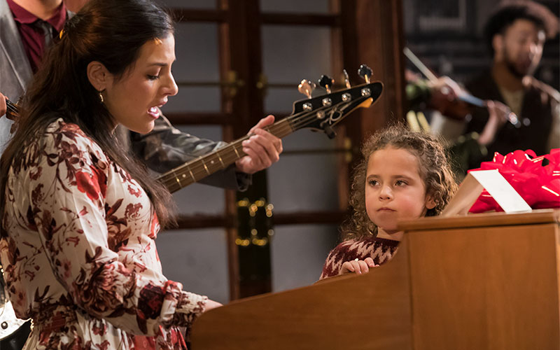 "Five-year-old Kennedy Kleps performs in Geva Theatre's production of ""Once,"" which opened in late February and runs through March 22. (Photo courtesy Geva Theater)"