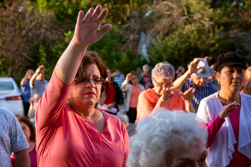 Elsie Vazquez raises her hands in a blessing during the third day of the annual Santa Misión at Holy Apostles Church in Rochester.