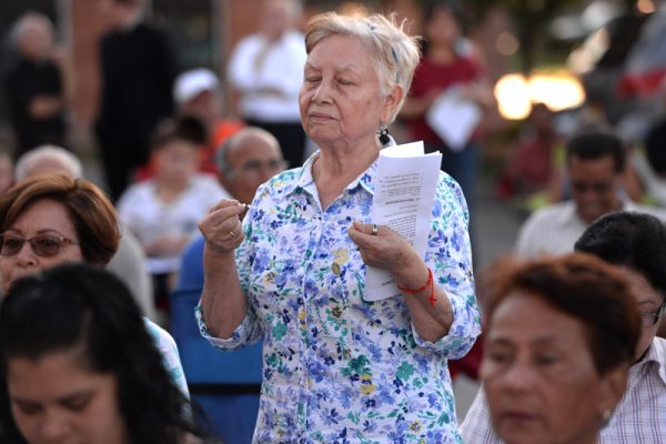Cristina Vasquez prays the rosary during the annual Santa Misión 2016 for the Latino community at St. Michael Church in Rochester, Monday Aug. 8.