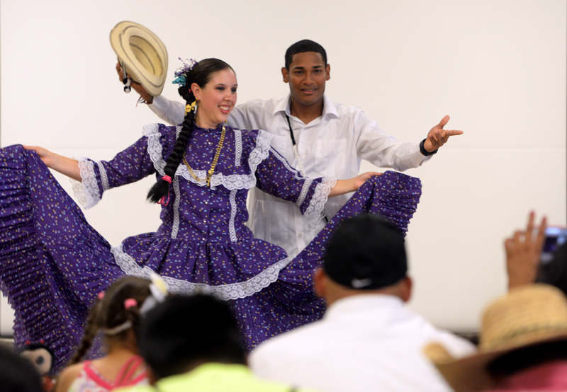 Amanda Alfaro and Thiem Chalá of Latinos de Corazon, a traditional Latin American dance group, perform during the Finger Lakes Coalition of Farmworker Serving Agencies second annual Harvest Festival to honor the farmworker community in Sodus, N.Y.