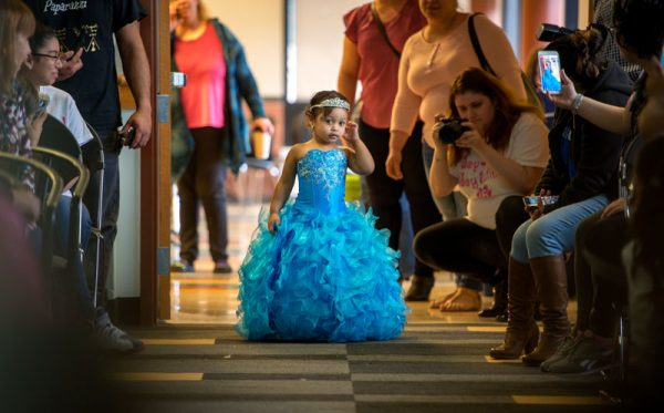 Three-year-old wears pageant dress.