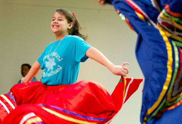Twelve-year-old Yarlinelys Rodrigues presents a traditional Mexican dance with other middle school students during the closing of ¡Soy Unica! ¡Soy Latina! Rally held by Latinas Unidas April 19 at Nazareth College.