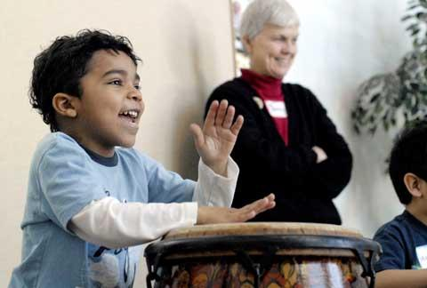 Julio Montilla learns to play African drums.
