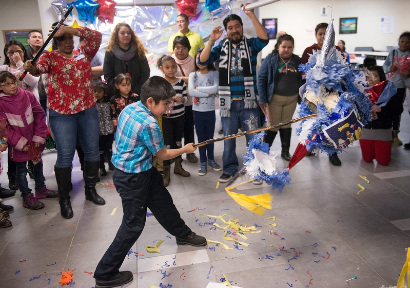 Eliseo Lagunas attempts to break a pinata during a Christmas Fiesta at Brockport High School Jan 20.