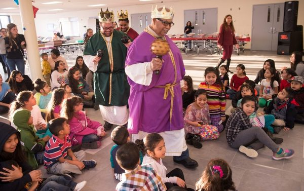 The Three Kings, portrayed by Kenny Carmona, Alex Figueroa and Juan Vazquez, make their way through the crowd during a Christmas Fiesta at Brockport High School Jan 20.