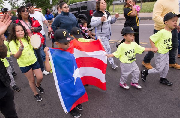 Players and parents take part in the Rochester Hispanic Youth Baseball League's 2018 opening day parade in Rochester June 2.