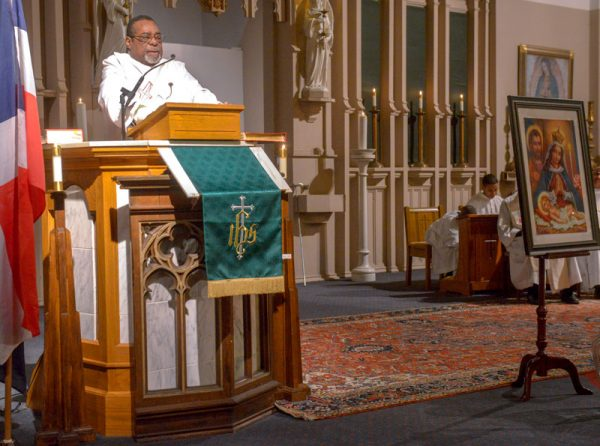 "Deacon Bienvenido ""Benny"" DeJesús gives the homily."