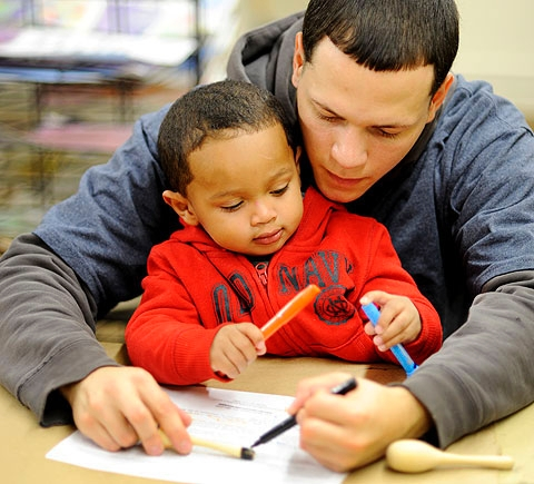 Angel Fernandez and his son Angel make mini-maracas.