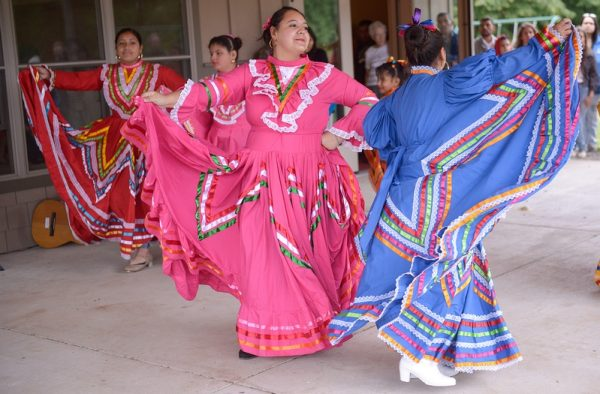 Members of Ballet Folklorico perform a traditional dance at Sweden Town Park Sept. 9 as part of a bienvenida celebration welcoming migrant farmworkers to the area.