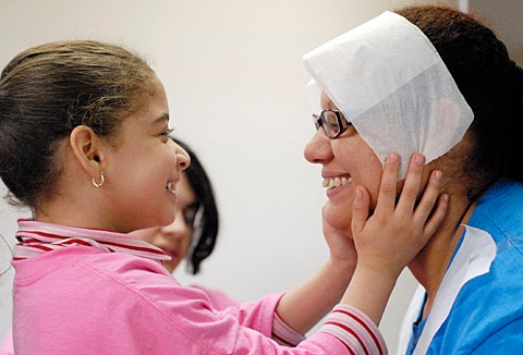 Petra Mendez, 7, smiles at her mother during a workshop activity.