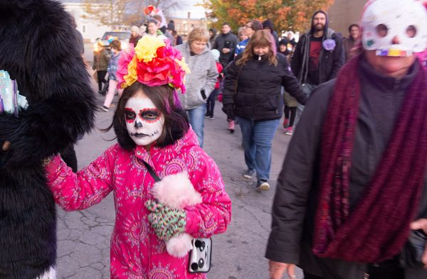 People walking in a Day of the Dead parade.