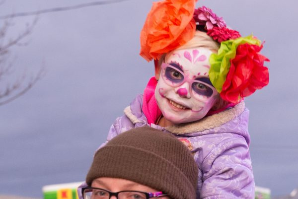 A child with her face painted.