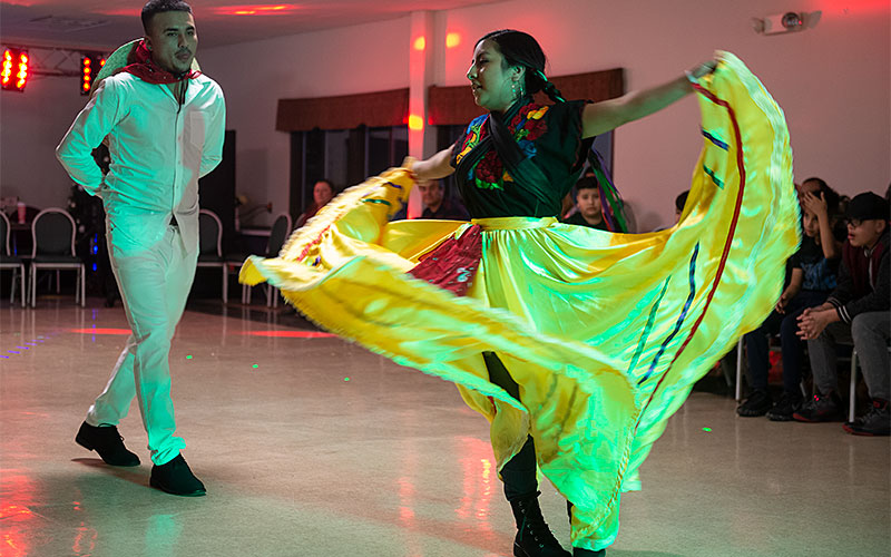Two people perform a Mexican folk dance.