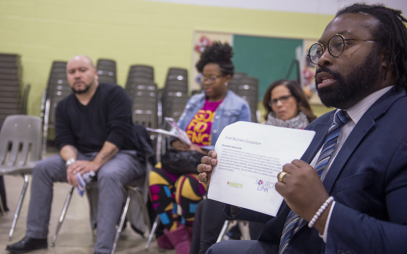 Lomax Campbell, director of community wealth for the City of Rochester, speaks during a Feb. 24 community meeting regarding La Marketa at the International Plaza.