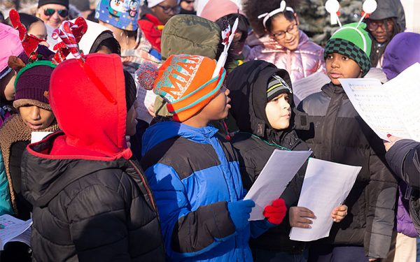 Students sing a Christmas carol during the tree lighting.