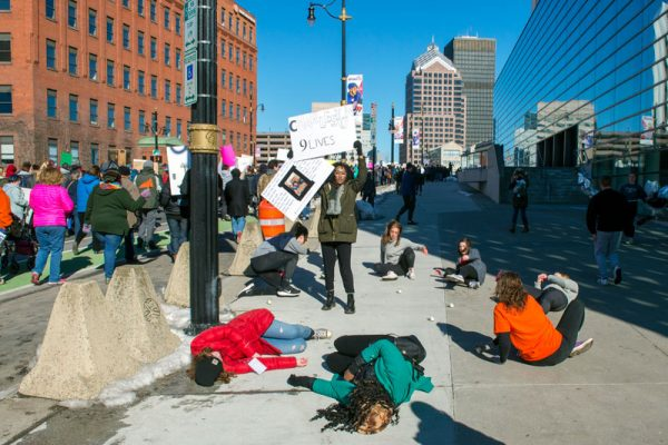 Student demonstrators play dead on Broad Street to call attention to those who have lost their lives to gun violence.