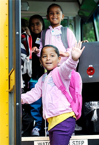 Lysmarie waves as she gets on the bus.