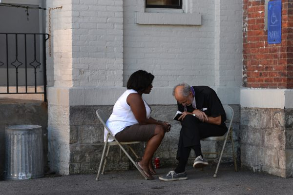 Father Bob Werth listens to Jvelisse DeJesus during an outdoor confession which is part of the annual Santa Misión 2016 for the Latino community at St. Michael Church in Rochester, Monday Aug. 8.