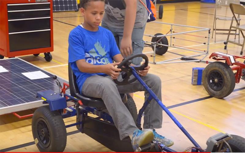 Kid drives solar car